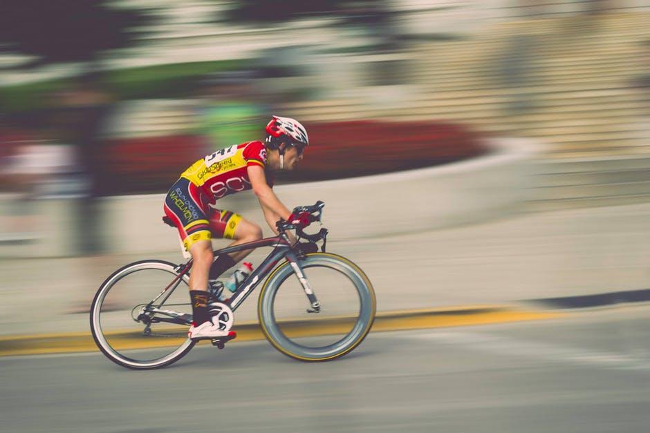 Exercise Bike benefits man racing