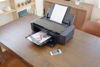 Ricoh Printer on desk with paper