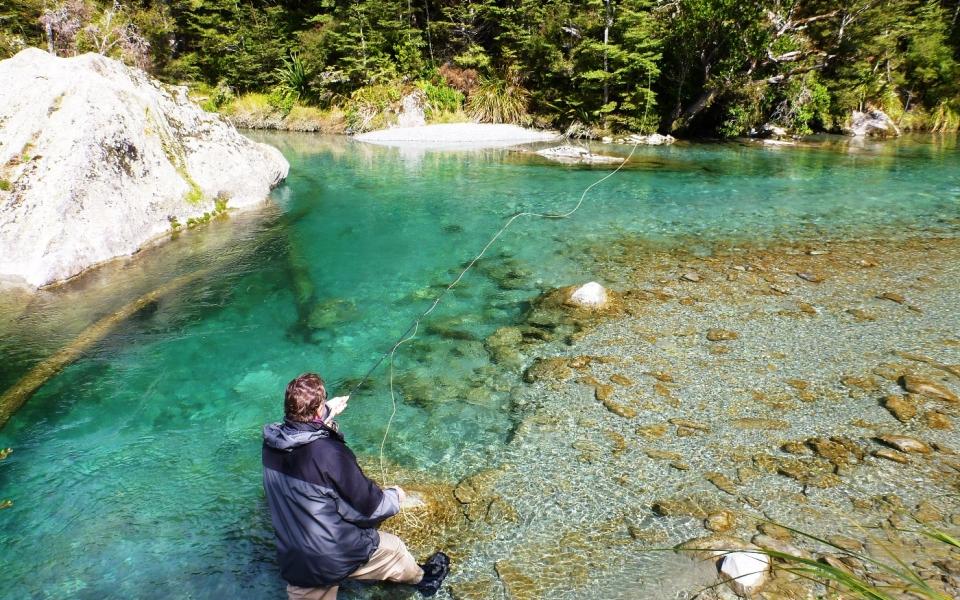 New Zealand man fishing in water