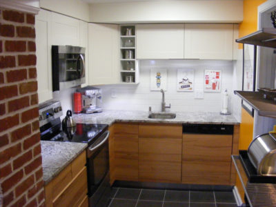 tiny kitchen with red brick walls