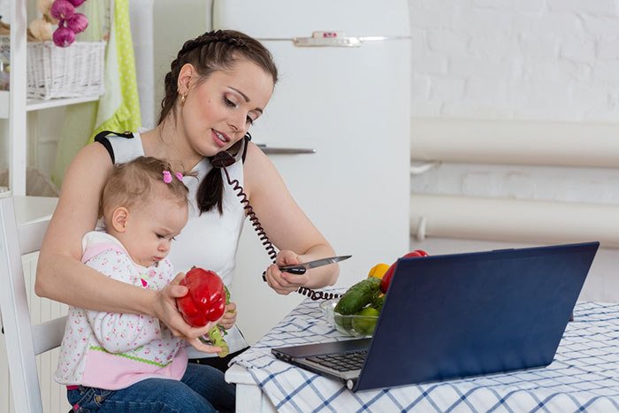 Cooking Tips mom with baby on laptop
