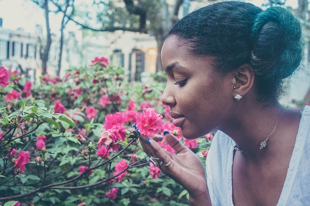 woman smelling flowers happy
