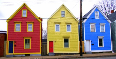 yellow house between red and blue house