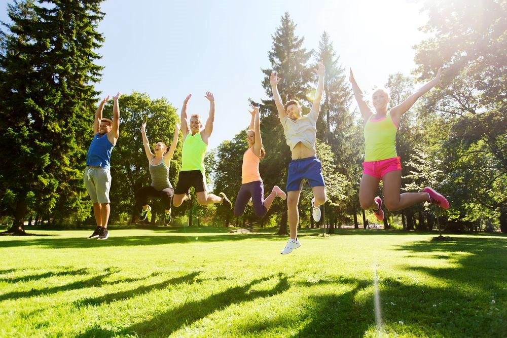 people jumping and exercising outdoors