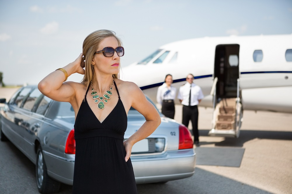 Airport transfer woman waiting for cab