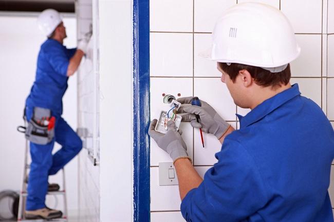 Rewiring home electrician blue suit
