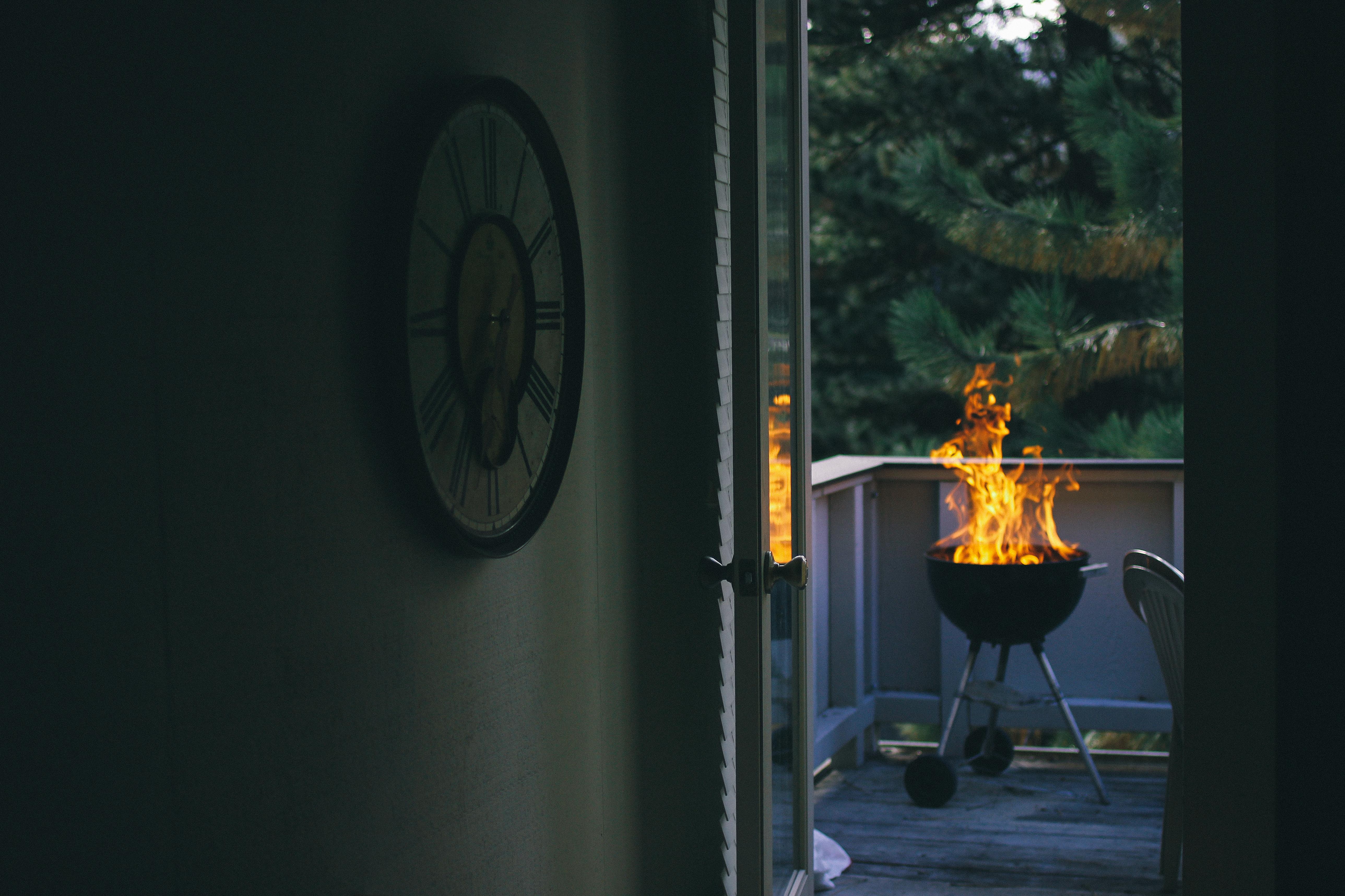Beautiful Backyard fire pit grill on fire