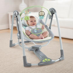 baby in portable swing set