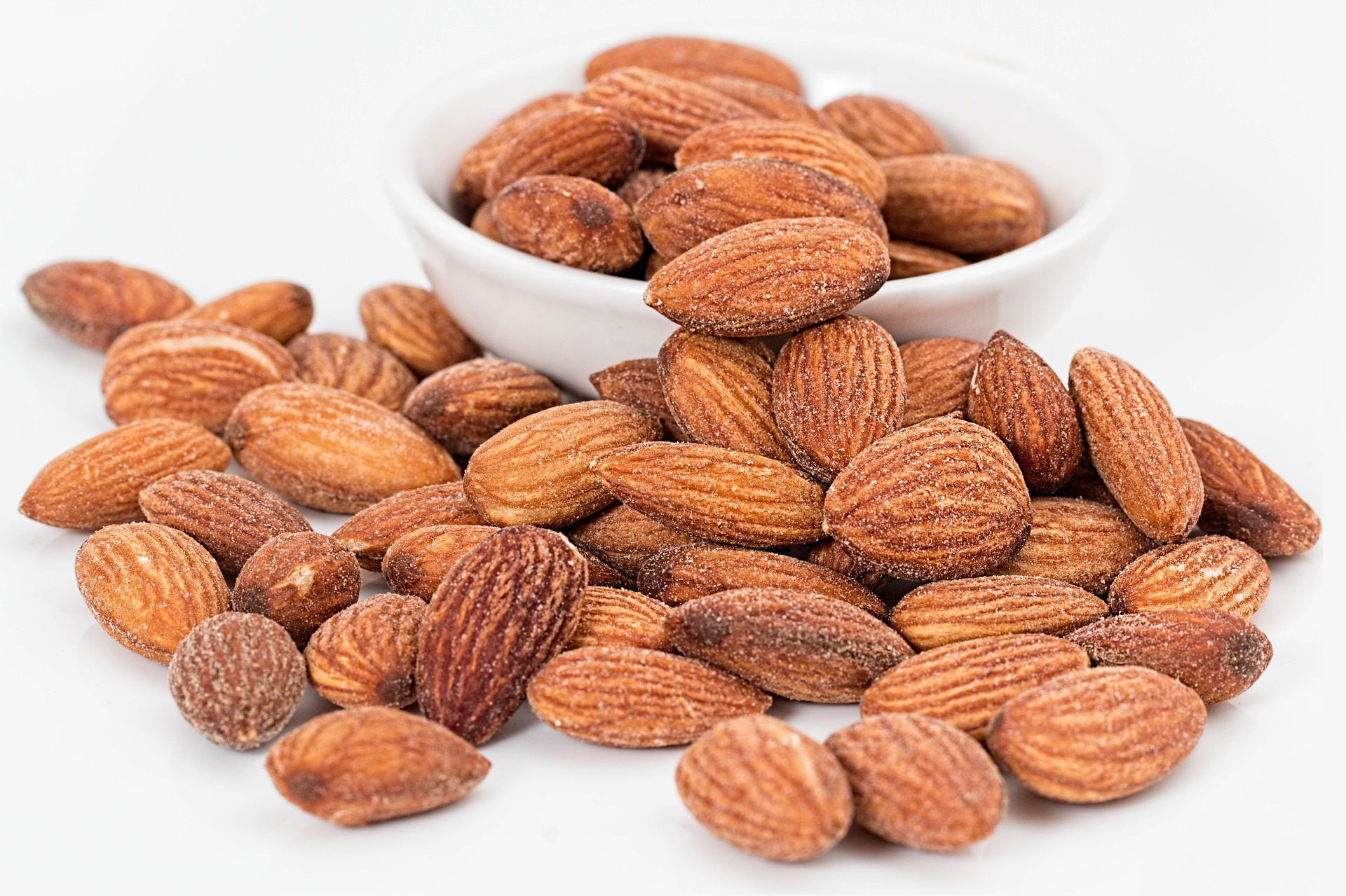 Super Foods almonds handful white backgroud