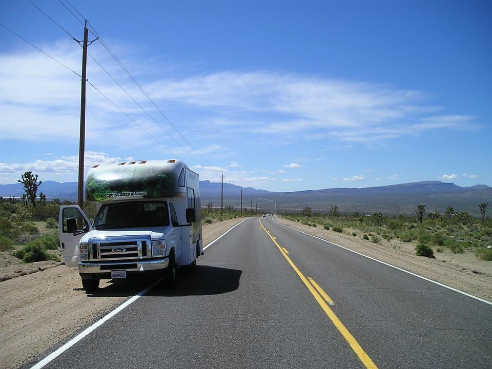 caravan bus on side of the road