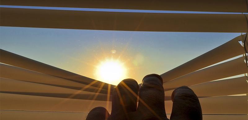 Venetian Blinds open sunlight coming in