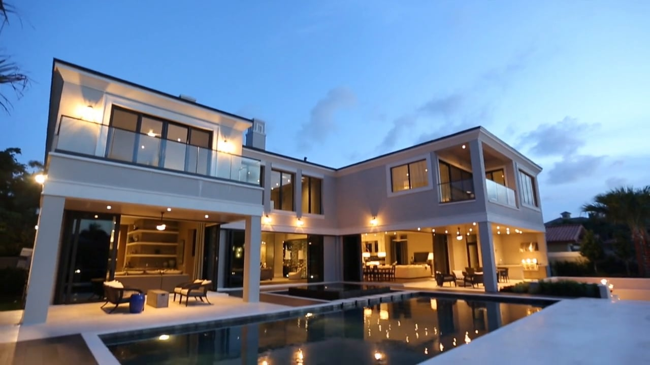 outdoor shot of luxury home and pool