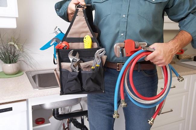 Experienced Plumber handling tools