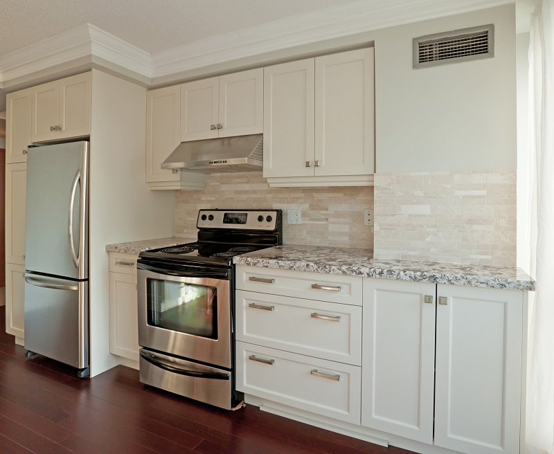 Two Pack Cabinets stove in corner