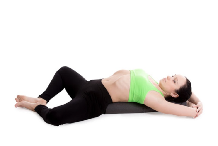 yoga stretch on floor mat