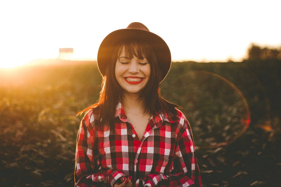 Smiling woman happy about summer and sunset