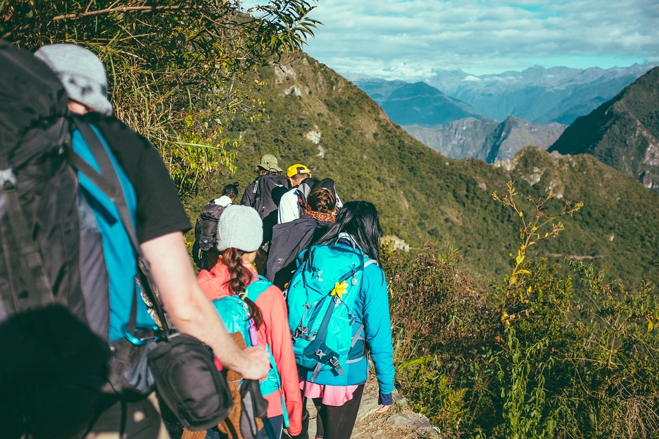 Group Travel together hiking on mountain