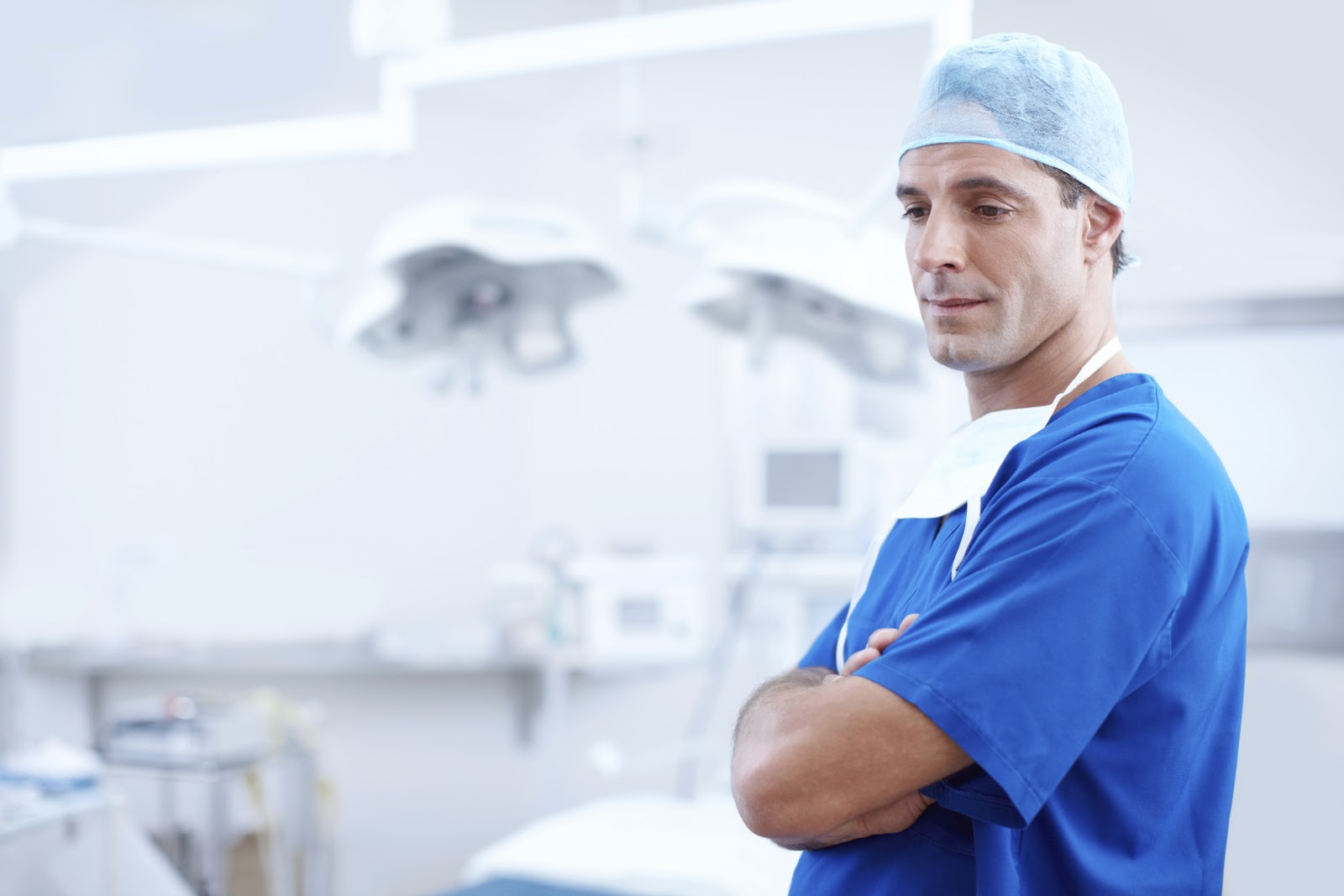 Doctor crossing arms in surgery room