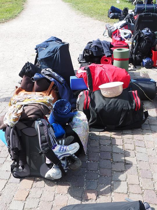 Group Travel back packs together