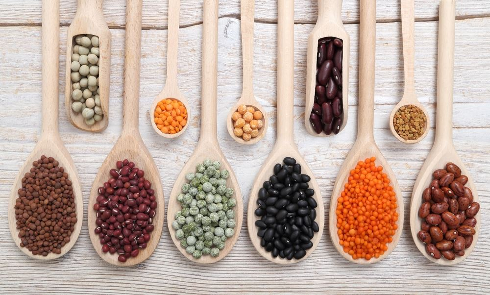 beans on wooden cooking spoons