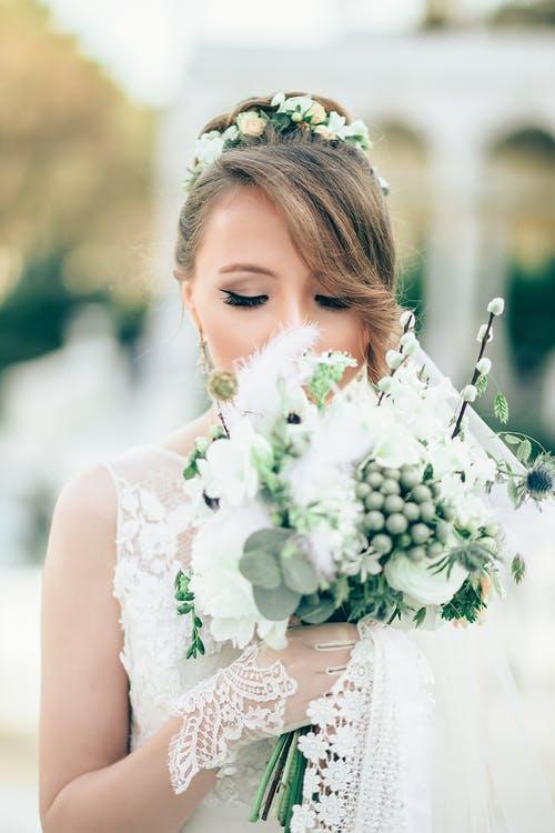 wedding blogs bride smelling bouquet
