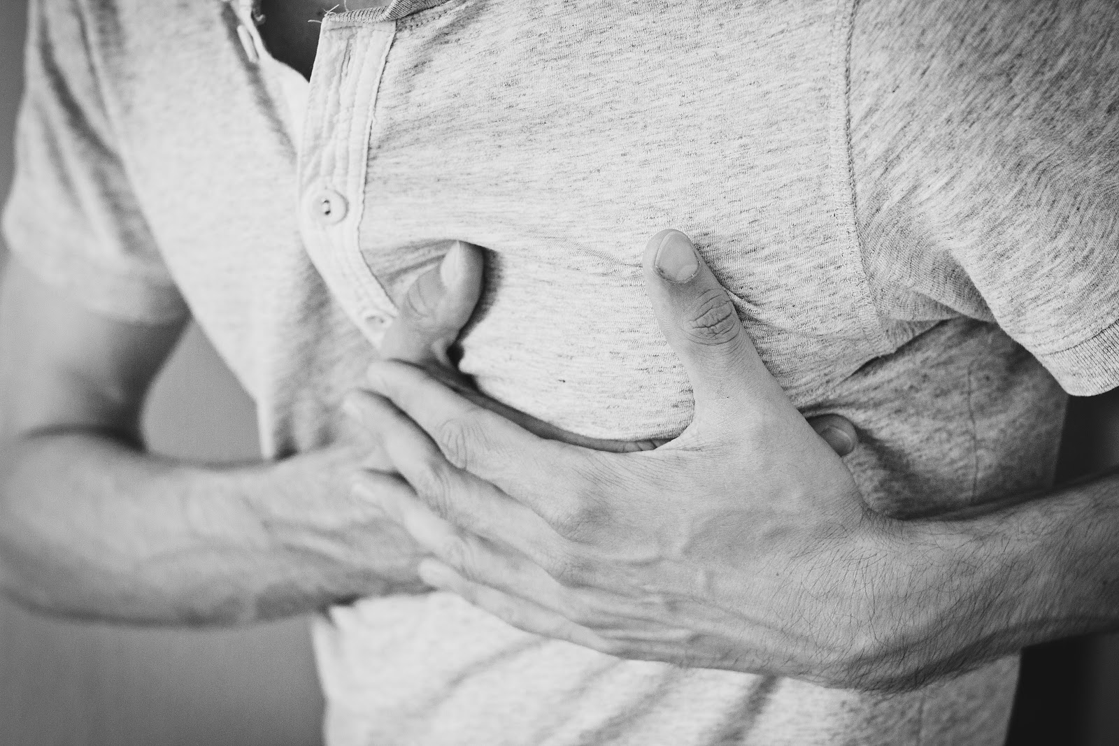 heart pain hands on chest