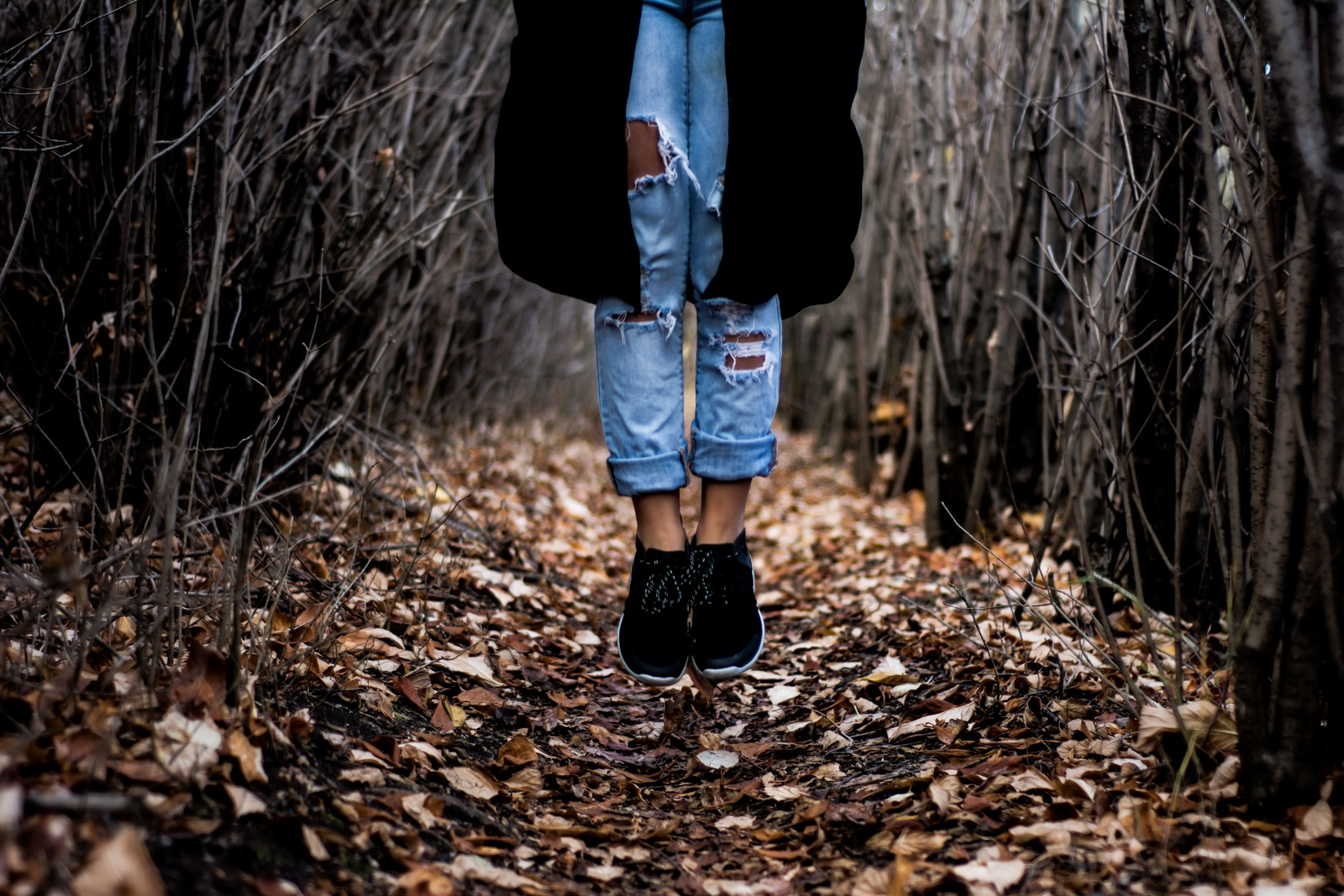 layers of fashion shoes on feet in woods