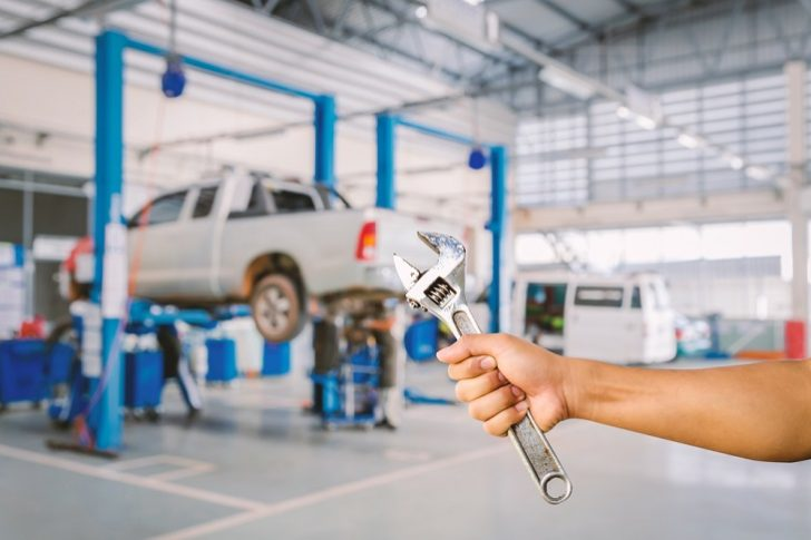 Car Servicing wrench in hand