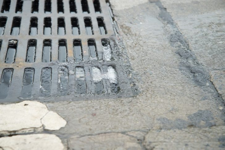 Blocked Drains Clearing on street