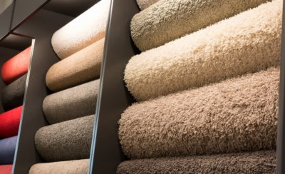 Fabric Wholesalers stacks of carpet in stock