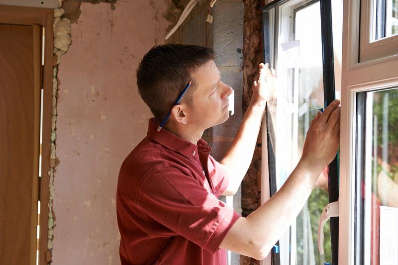 DIY Tips man repairing glass window