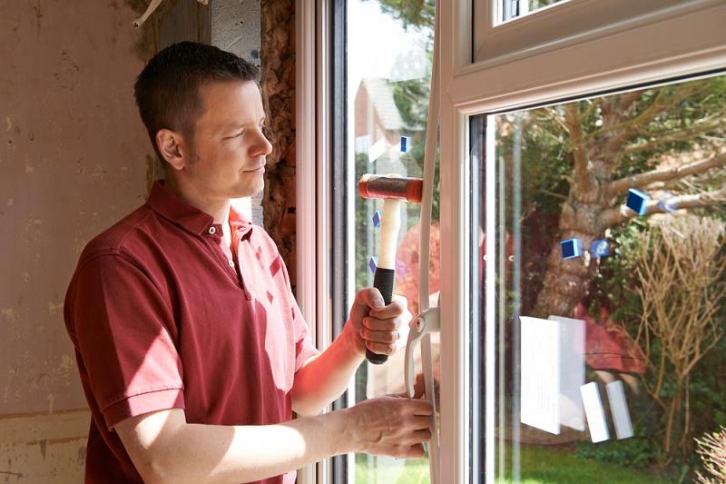 DIY Tips man working on glass window