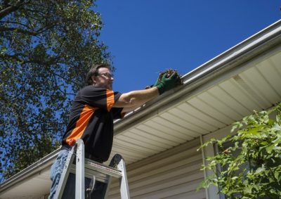 Gutter Replacement man cleaning