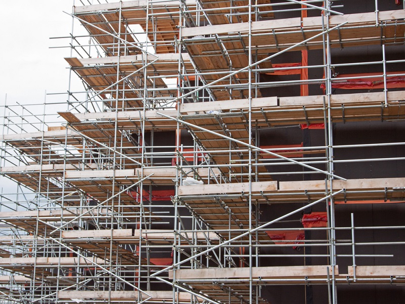 Scaffolding outside in structural surrounding of building