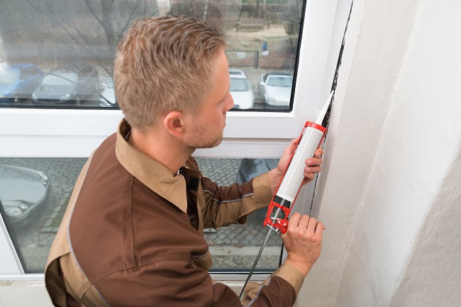 Waterproofing balcony man with caulk