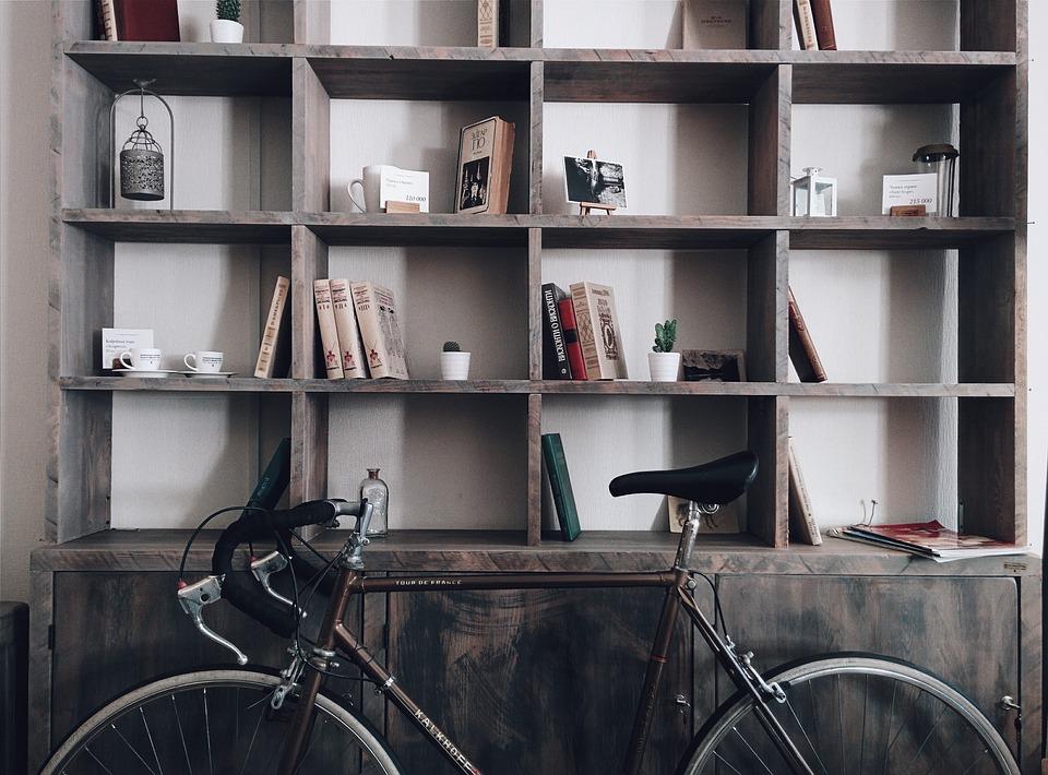storage bookshelf above bicycle
