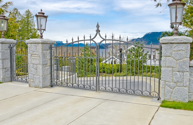 custom gate outside huge home