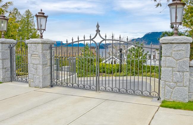 custom gate outside huge home