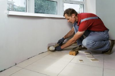 Install Vinyl Tiles man with tools