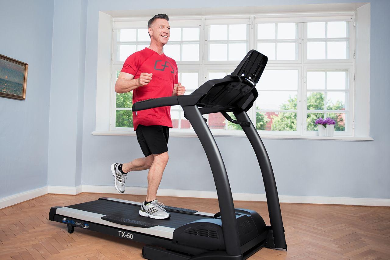 Treadmill man running happy