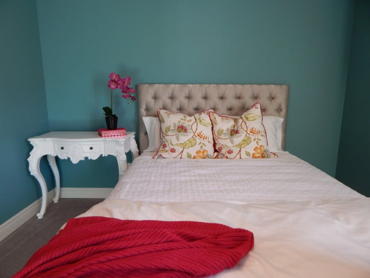 Sleeping Quarters white bed red blanket