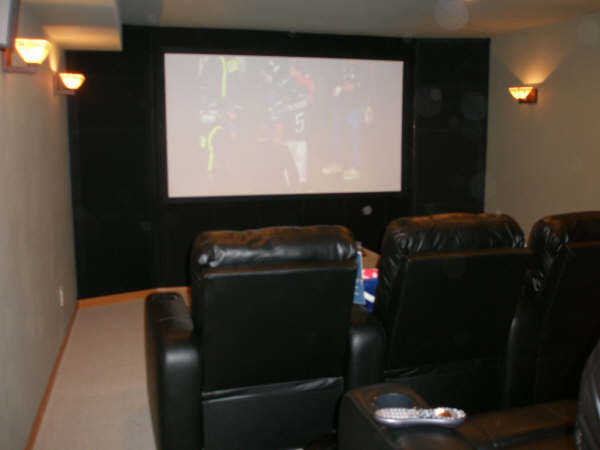 Home Cinema with chairs and big screen