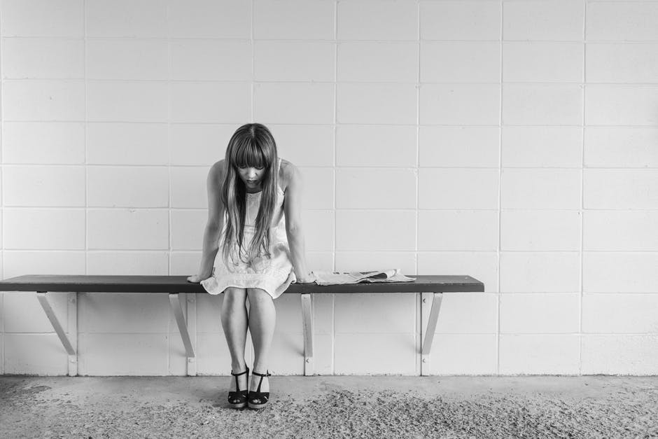 Bad Day girl sitting on bench depressed