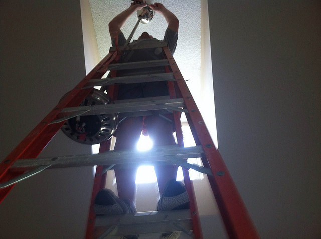 on ladder getting home ready for selling