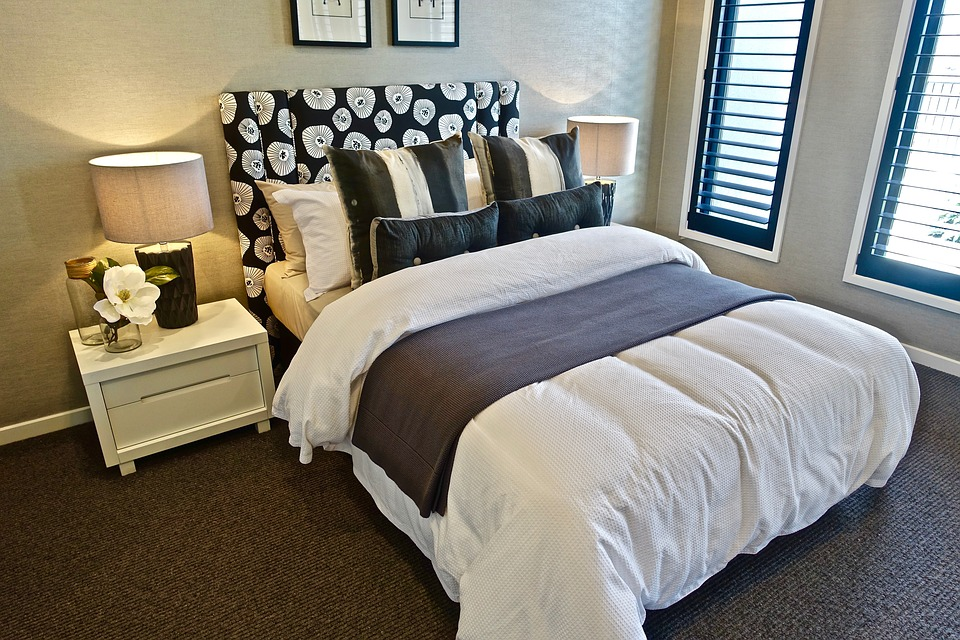 Sleeping Quarters white bed with throwover