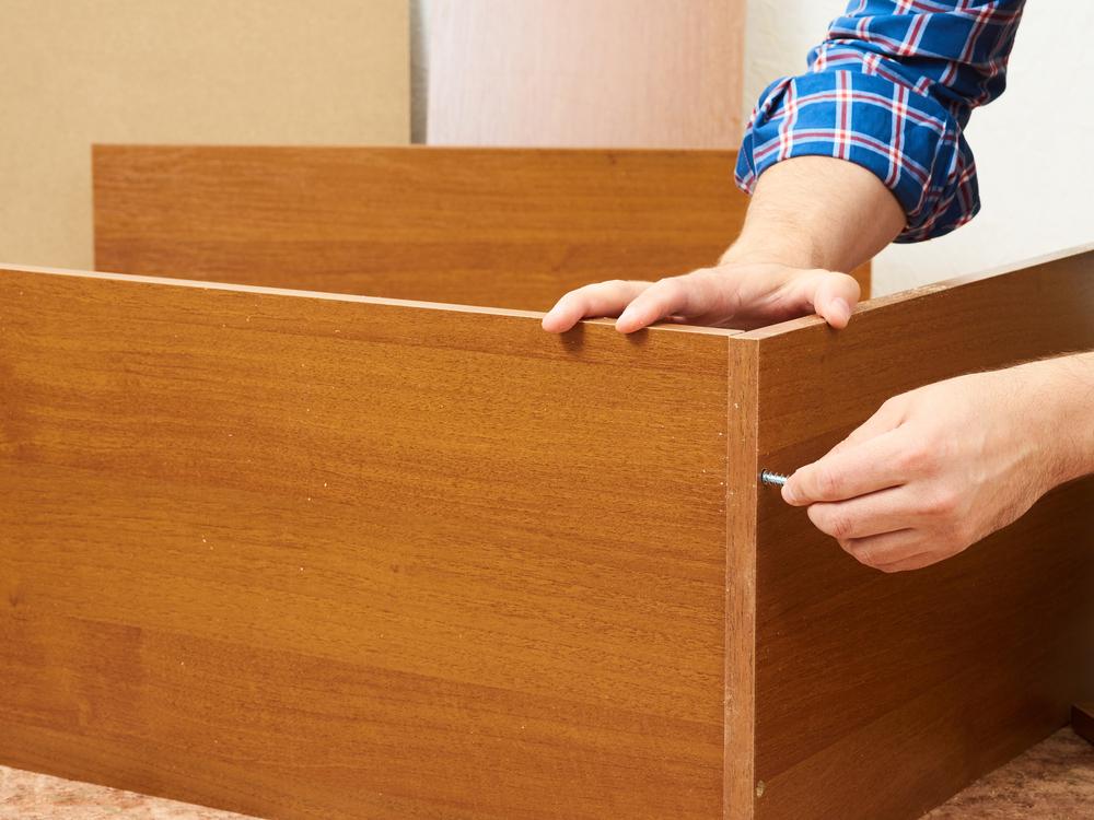 Make A Simple Bookshelf hands assembling wood