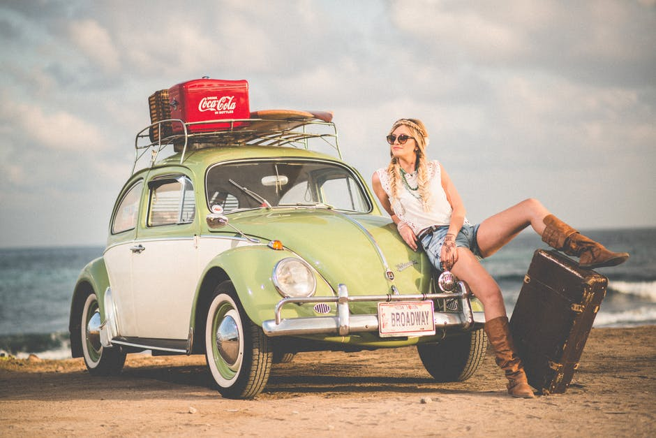 Millennials on beach with VW