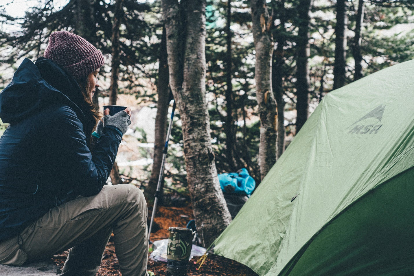 Camping woman in front of tent