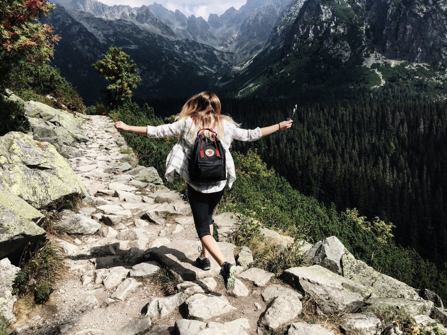 Camping woman on rocks