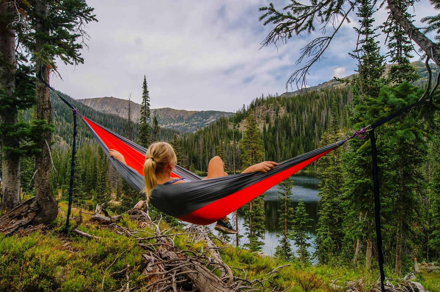 Camping woman in hammock